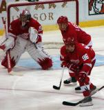 Jimmy Howard, Nicklas Lidstrom and Tomas Holmstrom line up for a faceoff in the Detroit zone.