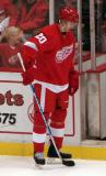 Drew Miller stands next to an open penalty box door.