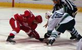 Darren Helm takes a faceoff against Vancouver's Ryan Johnson.