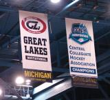 The Joe Louis Arena rafters and the banners honoring the champions of the Great Lakes Invitational and the CCHA Championship.