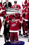 Steve Yzerman hoists the Stanley Cup after it is handed to him by NHL Commissioner Gary Bettman.