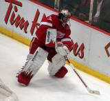 Jimmy Howard plays the puck from behind his goal.