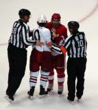 Patrick Eaves and Columbus' Kris Russell are pulled apart by officials after a fight.