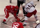 With Tomas Holmstrom on his wing, Pavel Datsyuk gets set for a faceoff against Columbus' Samuel Pahlsson.