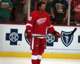 Mike Modano stands near the boards during pre-game warmups before a preseason game.