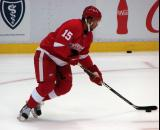 Jordan Owens carries the puck to the goal during pre-game warmups before a preseason game.