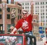 Nicklas Lidstrom salutes the Red Wings' back-to-back Stanley Cup wins during the 1998 parade.
