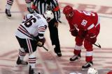 Mike Modano takes the opening faceoff of a preseason game against Chicago's Dave Bolland.