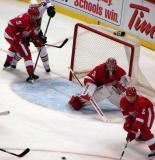 Jimmy Howard squares to the shooter while Nicklas Lidstrom covers the far side of the net and Brendan Smith attempts to knock the puck away during a preseason game.