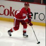 Brian Rafalski carries the puck along the boards during pre-game warmups.