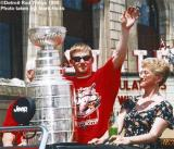 Chris Osgood waves to the crowd while holding the Stanley Cup in the 1998 parade.