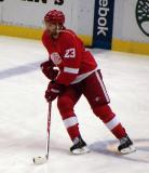 Brad Stuart carries the puck in the neutral zone during pre-game warmups.