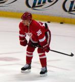 Jiri Hudler waits in the right faceoff circle during pre-game warmups.