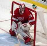 Jimmy Howard watches the action in the corner to his left in the second period.