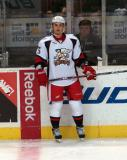 Ilari Filppula stands along the boards during pre-game warmups before a Grand Rapids Griffins game.