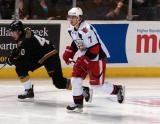 Brendan Smith trails Mathieu Tousignant in a Grand Rapids Griffins game against the Texas Stars.
