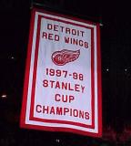 The banner for the Red Wings' 1998 Stanley Cup Championship is raised to the Joe Louis Arena rafters.