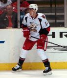 Chris Minard skates along the boards in a Grand Rapids Griffins game against the Texas Stars.
