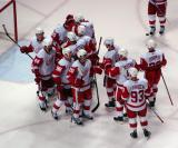 The Red Wings congratulate Jimmy Howard after a win.