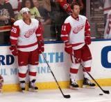 Brian Rafalski and Danny Cleary stand along the boards during pre-game warmups.