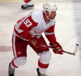 Johan Franzen skates across the blue line during pre-game warmups.