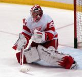 Jimmy Howard drops into the butterfly to face an oncoming shot during pre-game warmups.