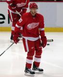 Drew Miller stands near the blue line during pre-game warmups.