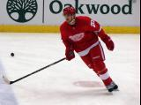 Drew Miller skates across the blue line during pre-game warmups.