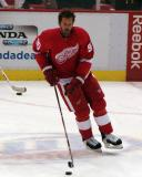 Mike Modano carries a puck in the neutral zone during pre-game warmups.