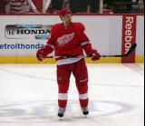 Niklas Kronwall inspects his stick during pre-game warmups.