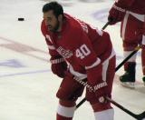 Henrik Zetterberg crouches at center ice during pre-game warmups before a preseason game.