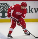 Gustav Nyquist stickhandles in the neutral zone during pre-game warmips before a preseason game.