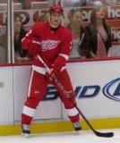Brendan Smith waits for the puck along the boards during pre-game warmups before a preseason game.