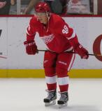Cory Emmerton crouches near the boards during pre-game warmups before a preseason game.