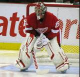 Ty Conklin gets set in his crease before the start of a preseason game.