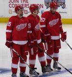 Niklas Kronwall, Bryan Rufenach and Landon Ferraro stand at the blue line after being introduced before the Red & White Game.