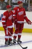 Joey Martin and Johan Franzen stand at the blue line after being introduced before the start of the Red & White Game.