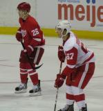 Gleason Fournier marks up on Jiri Hudler during the Red & White Game.