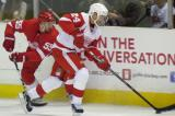 Pavel Datsyuk carries the puck away from Niklas Kronwall during the Red & White Game.