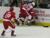 Trevor Parkes and Chris Conner fight for the puck along the boards with Francis Pare looking on during the Red & White Game.
