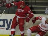 Greg Amadio recoils from hitting Nick Oslund during the Red & White Game.