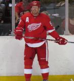 Johan Franzen stands along the boards during the Red & White Game.