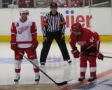 Pavel Datsyuk and Todd Bertuzzi talk while lined up for a faceoff during the Red & White Game.