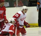 Brian Lashoff watches for a shot from the point while covering Johan Franzen during the Red & White Game.  Justin Abdelkader is also defending.