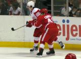 Chris Conner puts his stick into Mitchell Callahan during the Red & White Game.