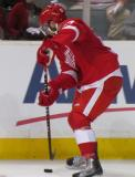 Landon Ferraro digs the puck out of his skates during the Red & White Game.