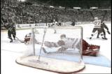 Chris Osgood dives to glove a Colorado shot out of mid-air in the 1996 Mastercard Cutting Edge Play of the Year.