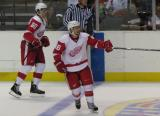 Jamie Johnson directs traffic with Trevor Parkes along the boards behind him during the Red & White Game.