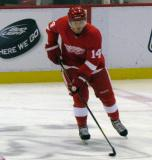 Gustav Nyquist carries a puck through the neutral zone during pre-game warmups before a preseason game.