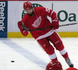Landon Ferraro plays with his stick while skating across the blue line during pre-game warmups before a preseason game.